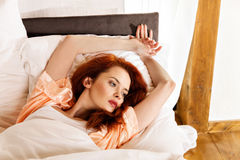 Woman sleeping on the white bed-clothes in bed at home Royalty Free Stock Photography