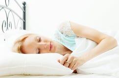 Woman sleeping on white sheet Royalty Free Stock Images
