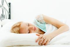 Woman sleeping on white sheet Stock Photos