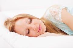 Woman sleeping on white sheet Royalty Free Stock Photos