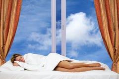Woman Sleeping by Window Stock Photography