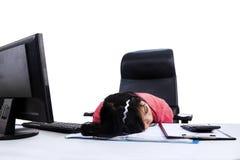 Woman sleeping at work Stock Photos