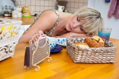 Woman sleepinh at breakfast table Royalty Free Stock Photo