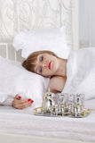 Woman sleeps on bed with white linen Royalty Free Stock Image