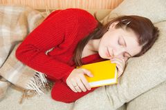 Woman sleeps with book Stock Photo