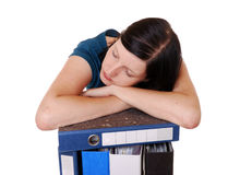 Woman sleeps on files Stock Images