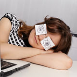 Woman sleeps in the office during working hours Royalty Free Stock Photos