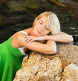 Woman sleeps outdoors Stock Images