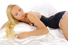 Woman. sleepy blond laying in bed Stock Photos