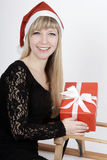 Woman with a sleigh and a gift Stock Photos