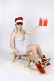 Woman on a sleigh with gift Stock Photos
