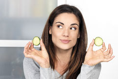 Woman with a slice of cucumber Stock Photo