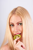 Woman with slice of kiwi Stock Image