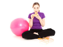 Woman with a slice of pizza and ball Stock Image