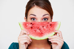 Woman with slice of watermelon. Portrait of woman with slice of watermelon royalty free stock photos