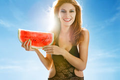 Woman with a slice of watermelon Stock Photos