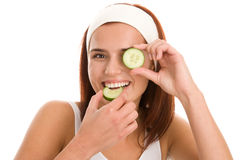Woman with slices of cucumber Stock Image