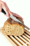 Woman Slicing Bread  Royalty Free Stock Image