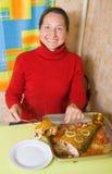 Woman slicing breaded fish Stock Photo