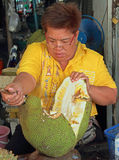 Woman is slicing jackfruit outdoor in Bangkok, Thailand Stock Images