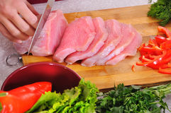 Woman slicing meat Royalty Free Stock Photo