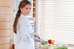 Woman slicing a pepper Royalty Free Stock Images
