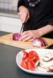 Woman Slicing a Red Onion Royalty Free Stock Images