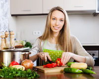 Woman slicing red pepper Royalty Free Stock Photography
