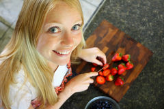 Woman Slicing Strawberries Royalty Free Stock Photography