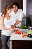 Woman Slicing Tomatoes With Her Boyfriend Stock Photo