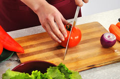 Woman slicing vegetables food Stock Photo