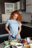 Woman slicing vegetables for salad Royalty Free Stock Photo