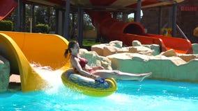 Woman sliding on water slide stock video