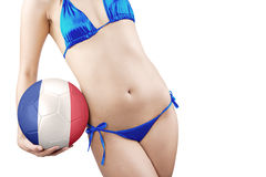 Woman with slim body holds a ball Royalty Free Stock Image