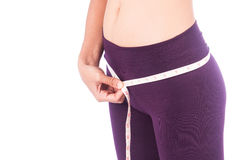 Woman with slim body measuring hips Stock Photos