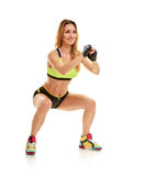 Woman with slim body. squatting Stock Images
