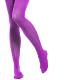 Woman slim legs and violet stockings isolated Royalty Free Stock Images