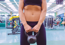 Woman with slim waist and black sportswear holding Royalty Free Stock Image