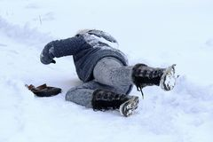 A woman slipped and fell on the winter road Royalty Free Stock Photos