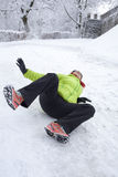 Woman slipped on a snow and ice Royalty Free Stock Photography