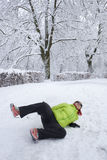 Woman slipped on a snow and ice Stock Image