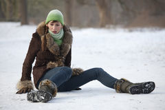 Woman slips on snowy road Royalty Free Stock Photography