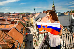 Woman with slovak flag in Bratislava. Young female tourist holding slovak flag in Bratislava city. Promoting tourism in Slovakia stock photography