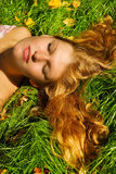 Woman Sluging On Grass Royalty Free Stock Images