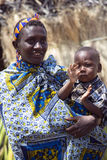 Woman with small children of the Hadzabe tribe Stock Image