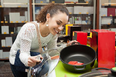 Woman in small domestic appliances section Royalty Free Stock Images