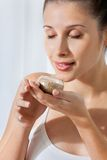Woman With Small Glass Jar Of Flax Seeds Stock Image