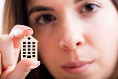 Woman with small house charm Stock Image