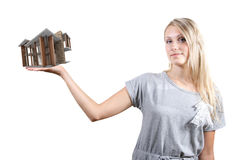 Woman with small house on the hand stock photos