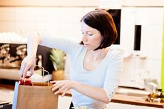 Woman small local shop owner packing shopping Royalty Free Stock Photo